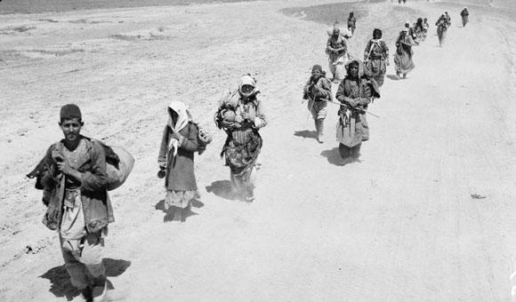 Armenische Flüchtlinge beim Überqueren der britischen Linien zur Zeit des Genozids.  Imperial War Museums.