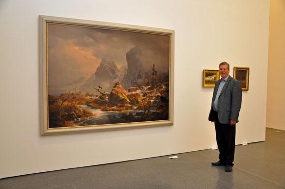Gerhard Langemeyer neben dem Gemälde von Andreas Achenbach, Nordisches Gebirge im Winter (1838) Foto: Anja Kador, Dortmund-Agentur